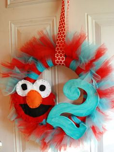 Elmo  Birthday TuTu Wreath by pickypickypeacock on Etsy, $45.00 ( this is easy to make with stuff from any art store)