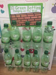10 green bottles activity. The bottles are velcroed on so the children can physically remove them as they sing.