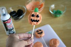 Oreo Dipped Pumpkin Lollipops