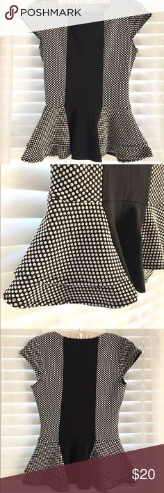 Peplum Black & White Polka Dot Top Peplum Black and White Polka Dot Top! Beautiful and comfortable! Snug at the natural waist and flows out over the hips! Smoke free home! 🌿 Happy to bundle! 💕 Tops Blouses