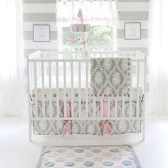 Bring a bright bit of fashion to your baby's nursery with this adorable 3-piece crib bedding set. The set uses a blend of damask, polka-dot, and stripe patterns to create a chic design. The set includes one quilt, one fitted sheet, and one crib skirt.