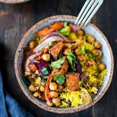 This fragrant turmeric rice bowl topped with leftover spiced roasted root vegetables and chickpeas is inspired by flavors from India for an easy, vegetarian dinner.
