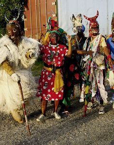 Jamaican Christmas: 'Jonkunnu a come!'  Policeman, Horsehead, Pregnant woman & Pitchipatchi are our characters Diablo is an older character maintained in other islands, this not a Jamaican photo.  Happily I saw ours again for the first time in years in St. Mary and St. Ann on Boxing Day