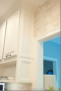 Add molding to existing cabinetry and paint Dancing Goddesses, Brick backsplash, zinc island raised and with architectural element seating support, poured and stained concrete counters Diy Kitchen Remodel, Kitchen Redo, Kitchen Remodeling, Open Cabinets, Kitchen Cabinets, Concrete Counter, Stained Concrete, House On A Hill, Painting Cabinets