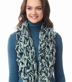 On the Double Arm Knit: Learn how to create this beautiful and chunky scarf to stay cozy all season with this free pattern!