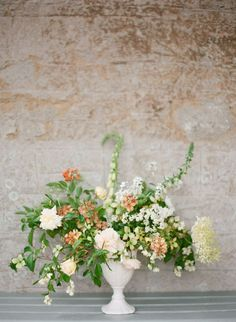 White footed urn - photography by Taylor & Porter florals by The Garden Gate Flower Co