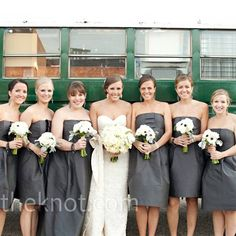 Sarah's bridesmaids wore strapless charcoal dresses with matching chandelier earrings and carried bouquets of white anemones, green lamb's ear and galax.  from the album: A Winter Wedding in Waco, TX