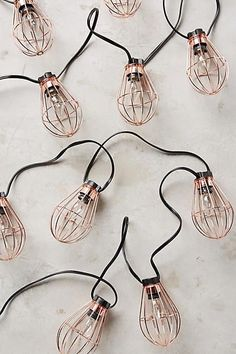 Caged Bulb String Lights Rose Gold outdoor patio lighting from Anthropology My New Room, My Room, Samsung Wallpapers, Deco Rose, Bijoux Design, Copper Rose, Deco Design, Fairy Lights, String Lights