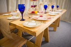 Blue glass, vintage crockery, hessian table runners and rustic tables, the dream country wedding