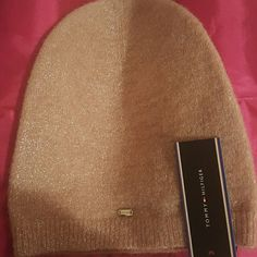 Tommy Hilfiger shimmery hat Brand new Tommy Hilfiger shimmery, light pink hat. Tommy Hilfiger logo on the front. Never worn and in excellent condition. Matching scarf too. Can be sold together or separetely. Tommy Hilfiger Accessories Hats