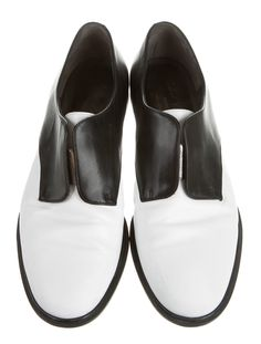 0662d359add2b Black and white leather Robert Clergerie round-toe oxfords with elasticized  panel at vamp and