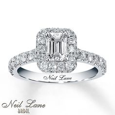 A captivating emerald-cut diamond is the star of this engagement ring from the Neil Lane Bridal® collection. Round diamonds frame the center and line the band of 14K white gold, which features Neil Lane's signature on the inside. The diamond engagement ring has a total diamond weight of 1 3/8 carats. Diamond Total Carat Weight may range from 1.37 - 1.44 carats.