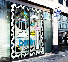 In November 2018 Ju Schnee was asked to paint the shop window front of Adidas Originals Flagship store in Berlin. She wanted to create a young and fresh vibe Window Display Design, Store Window Displays, Window Wrap, Window Signage, Window Graphics, Signage Design, Mural Painting, Window Decals, Grafik Design