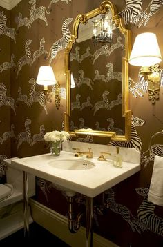Great powder room.  Love the wallpaper and mirror.