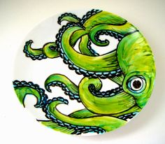 painted up a vintage plate with my green octopus design. I love his eyeball.