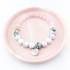 Created using beautifully marbled howlite stone and rose quartz beads with feature silver & rose gold beads. Length: XS - elasticised band will...