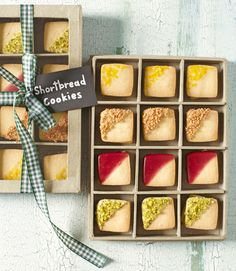 Displayed in a clear-topped checkerboard box, bite-size shortbread cookies—dipped in fruity glazes, chopped nuts, and citrus zest—pass for tiny works of art.