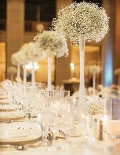 Yes simple babies breath can have breathtaking impact all by itself. Tall vases ensure clear sightlines for your guests. Helen Blakey Flowers can work with you to create this look for your wedding flowers!