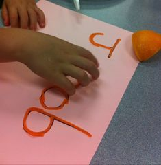 practice letter formation by writing words on paper and having kids use precut wikki stix pieces to form letters