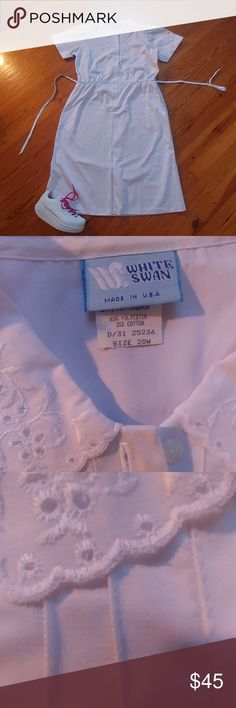 NWOT Vintage plus size white swan uniform Lace collar. Lace sleeves. Button-front, elastic waist, kick pleat skirt.  2 working pockets Size 20w.  Measures approximately 23 in from underarm to underarm.  Waistline measures approximately 20 in flat.  Hips measure approximately 26 inch flat. Length measures approximately 46.5 inches from shoulder to hem line Never worn . Superb condition! *See listing for shoes* vintage Dresses