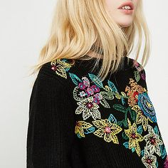 Mid weight knit Floral embroidered front Crew neck Long sleeve