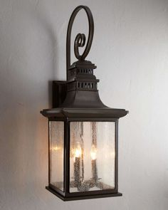 """Lantern-style light made of metal and clear seeded glass. Oiled bronze finish. Uses three 60-watt bulbs. Direct wire; professional installation required. 11""""W x 10.5""""D x 31""""T. Imported. Boxed weight,"""