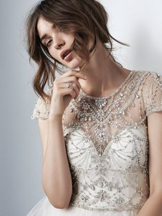 Sottero and Midgley - EMERY, Vintage-inspired beading and Swarovski crystals dance over the bodice of this tulle ballgown wedding dress, completing the illusion jewel over sweetheart neckline, illusion cap-sleeves, and illusion back with keyhole cutout. Finished with crystal buttons over zipper closure.