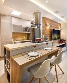 Mais uma cozinha incrível integrada totalmente ao estar. Uma ilha central serviu de anteparo para uma bancada para refeições.