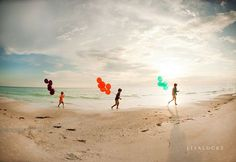run with balloons on the beach
