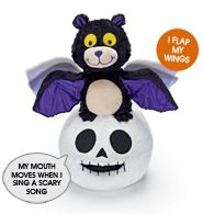 """Simon and Skully Halloween Duo.  Avon exclusive. Swings and sways to a scary tune, """"Halloween Bounce."""" Simon (the bat) flaps his wings. Skully's mouth moves when it sings a scary song. Uses 3 AA batteries (not included). 10 1/2"""" L x 6"""" W x 11 1/2"""" H. Plush. Imported.     For decorative use only. This is not a toy. Keep out of reach of children."""