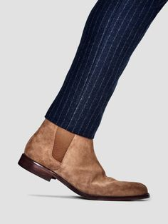minimalismbybrianalbiter:Penthouse Look, Basement Price First pair? Go suede. Like baseball mitts and Keith Richards's liver, suede boots get better with hard use. Pair 'em with a knifesharp pinstriped suit.