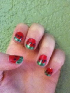 Watermelon nails!! How 2 do: first I began with a coat of red. I let dry then I stuck on my reinforcement labels near the tip. (As if I were to do French tip)  I painted a light green on the tip then 2 - 3 dark green lines. Peel off the labels. Then get your dotting tool and dot three black dots on the red. Let dry and you have your watermelon nail!!