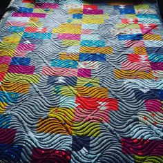 """This quilting is AMAZING!  Don't you just love those happy colors too? #quiltsofinstagram #quilts #quilting #Repost @apqsquilting ・・・ We can't get enough of this modern throw quilted by Charlotte! She used a 15"""" paper pantograph pattern called """"Time Warp"""" from Digi-Tech Designs. Well done! #apqs #quiltsofinstagram #longarmquilting"""