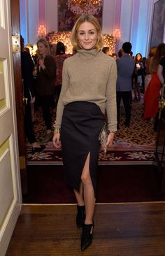 For the launch of Maison Makarem at London Fashion Week, Olivia perfected the art of sophisticated sexy dressing in a slit skirt and a turtleneck.