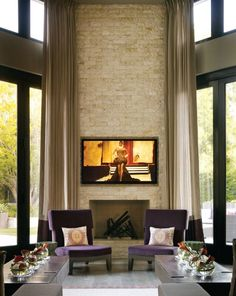 Stone fireplace w/ built-in TV niche; Rachel Laxer