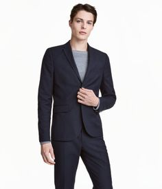 Dark blue. Blazer in woven fabric. Chest pocket, front pockets with flap, and two inner pockets, one with button. Decorative buttonhole on lapel. Buttons at