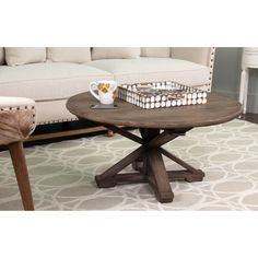 A conversation piece with upscale ambience, this beautifully crafted coffee table was designed to lend a rustic style to any space.
