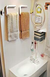 A flat toilet paper holder makes a great space saving  towel rack ...... use in the Casita