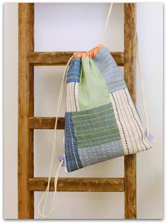 Learn How to Sew a Classic Drawstring Patchwork Backpack