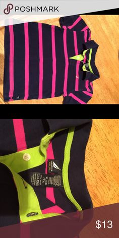 Boys Nautica Polo Shirt This polo shirt will look super cute on your little guy by NAUTICA!  In the color Navy with an awesome stripe color that pops at you in PINK with that lime green shout out at the buttons is in like new condition Nautica Shirts & Tops Polos