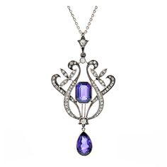 Whimsical diamond-set-platinum lines flow gracefully around the gorgeous amethyst center, epitomizing the organic nature of Edwardian design. Handmade and designed in wonderful fashion, this antique pendant possesses extremely fine amethyst displaying vivid color and wonderful clarity. 1915