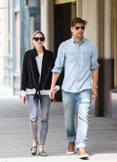 Olivia Palermo steps out with her husband in torn grey skinny jeans, camo loafers, and a back jacket.