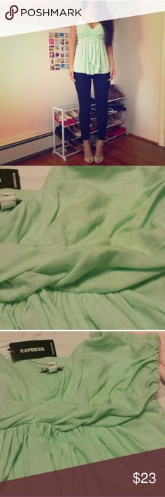(NWT) Mint Green Babydoll Tank Lightweight cotton-blend jersey forms a tank that has the power to transform. With curve-enhancing twisting and ruching at the bustline, plus a draping fit over the middle, it flatters and conceals where you want it to. Express Tops Tank Tops