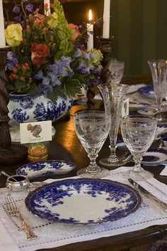 Formal Table in French Style: Linen placemats, blue and white French porcelain edged in gold. French silver and etched crystal Champagne flûte with an old blue and white chinoiserie soup tureen.