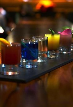 The Seven Deadly Sins shots  - Alcoholic shot recipes: Striking party shooters - Bar manager Ben-Newton Syms at Anise has been inspired by the Seven Deadly Sins when creating this colourful stick of seven shooters. They're a good - and tasty - way to remember the cardinal vices...