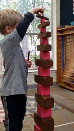 Greystone House Montessori School. Brown stair and Pink Tower extension lesson