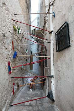 reminds me of a laser security field. | Found objects in small alleys by Brad Downey and Akay