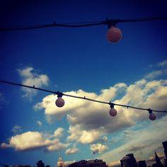 Big city sky & string lights @sarajanekauffmann