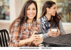 Portrait of a gorgeous Hispanic young woman hanging out with her friends and…