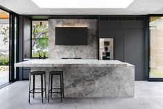 We were engaged to redesign the home's kitchen. The homeowners requested an open-plan, minimalist space suitable for entertaining. Stone Benchtop Kitchen, Quality Kitchens, Black Cabinets, Old Kitchen, Minimalist Interior, Cool Kitchens, Kitchen Design, New Homes, House Design
